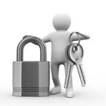 Person Holding a Key and a Lock